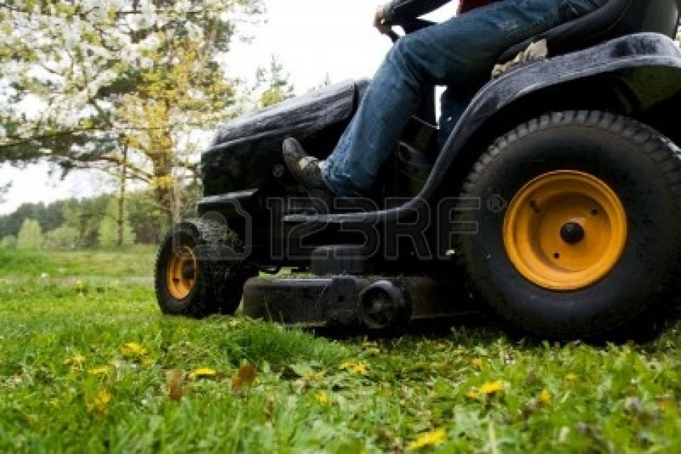 4922811-worker-mowing-with-black-riding-lawn-mower